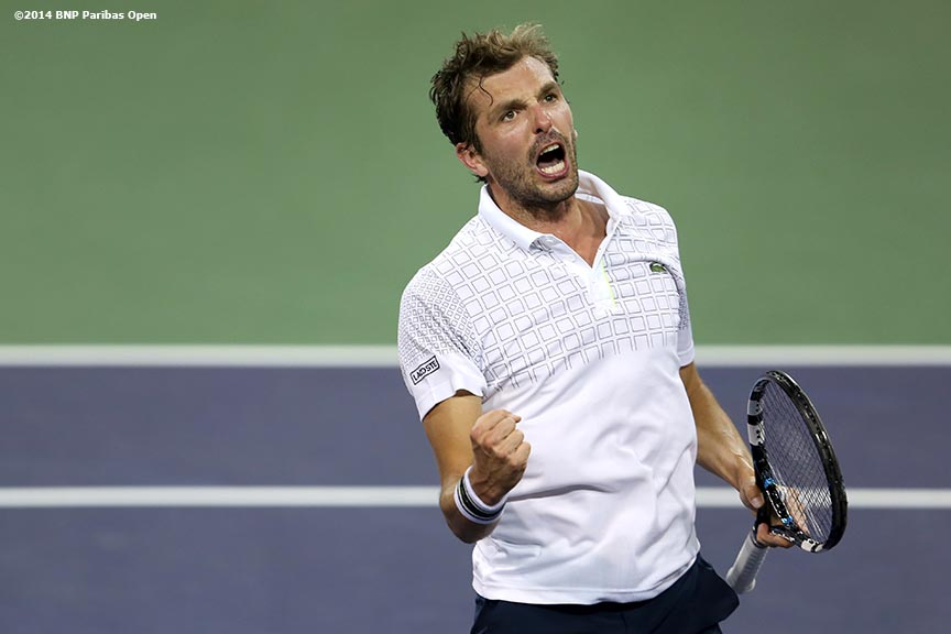 """Julien Benneteau reacts after defeating Dominic Thiem in the third round of the 2014 BNP Paribas Open Tuesday, March 11, 2014 in Indian Wells, California."""