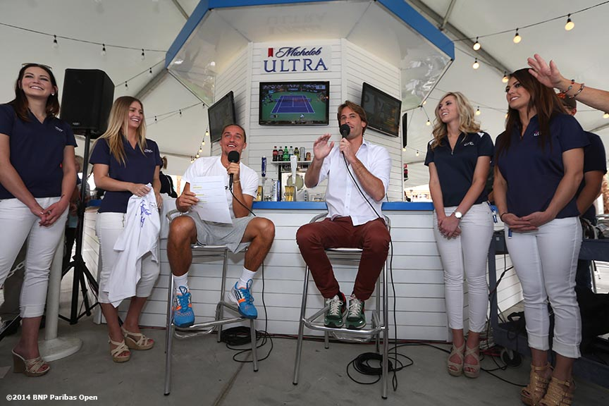 """Alexandr Dolgopolov chats in the Michelob ULTRA booth during the 2014 BNP Paribas Open Tuesday, March 11, 2014 in Indian Wells, California."""