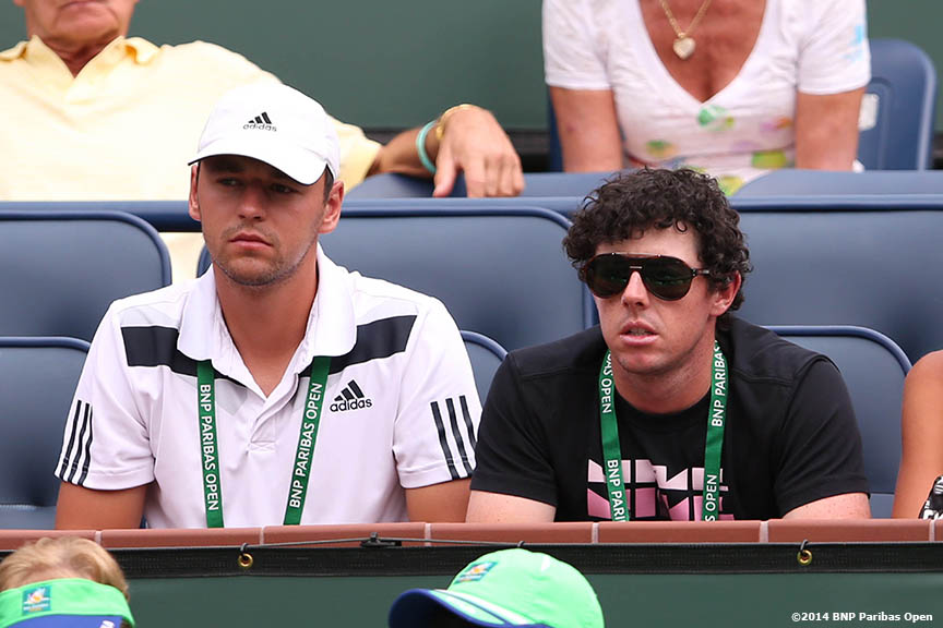 """Golfer Rory McIlroy watches a match between Caroline Wozniacki and Jelena Jankovic at the Indian Wells Tennis Garden Tuesday, March 11, 2014 in Indian Wells, California."""