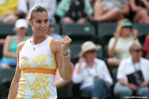 """Flavia Pennetta reacts after defeating Camila Giorgi in the fourth round of the 2014 BNP Paribas Open Tuesday, March 11, 2014 in Indian Wells, California."""