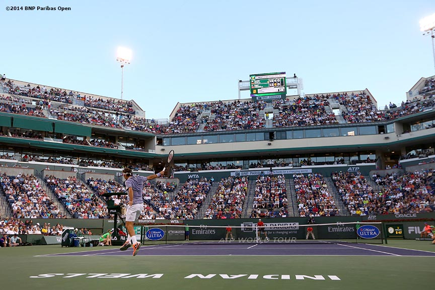 """Roger Federer serves to Tommy Haas at the 2014 BNP Paribas Open Wednesday, March 12, 2014 in Indian Wells, California."""