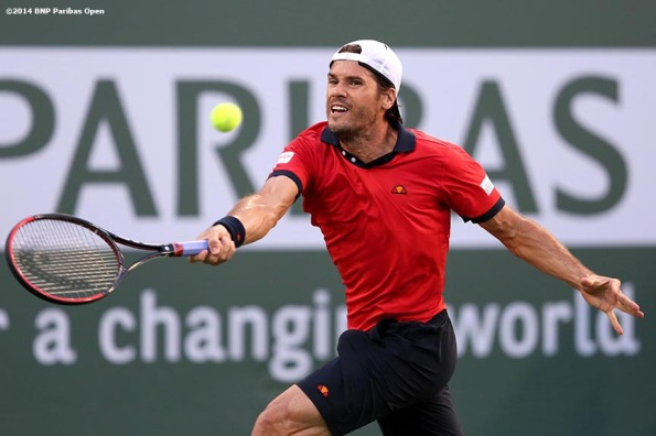 """Tommy Haas returns a shot from Roger Federer at the 2014 BNP Paribas Open Wednesday, March 12, 2014 in Indian Wells, California."""