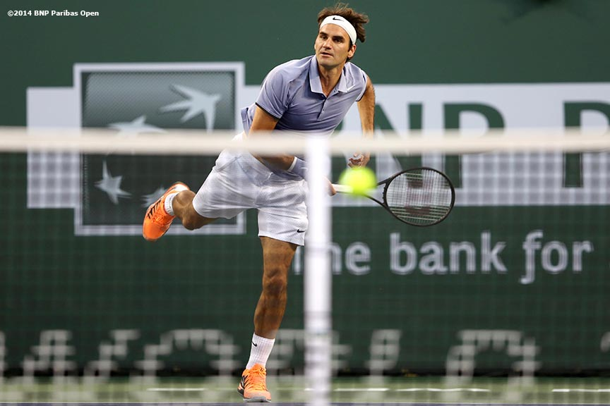 """Tommy Haas plays Roger Federer at the 2014 BNP Paribas Open Wednesday, March 12, 2014 in Indian Wells, California."""