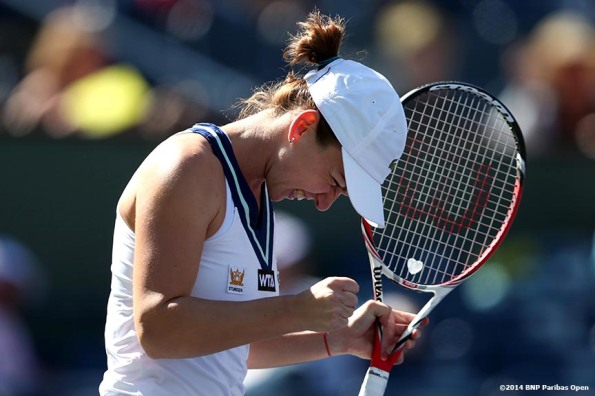 """Simona Halep reacts after defeating Casey Dellacqua at the 2014 BNP Paribas Open Wednesday, March 12, 2014 in Indian Wells, California."""