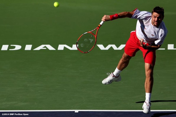 """Stan Wawrinka serves to Kevin Anderson during the BNP Paribas Open Wednesday, March 12, 2014 in Indian Wells, California."""