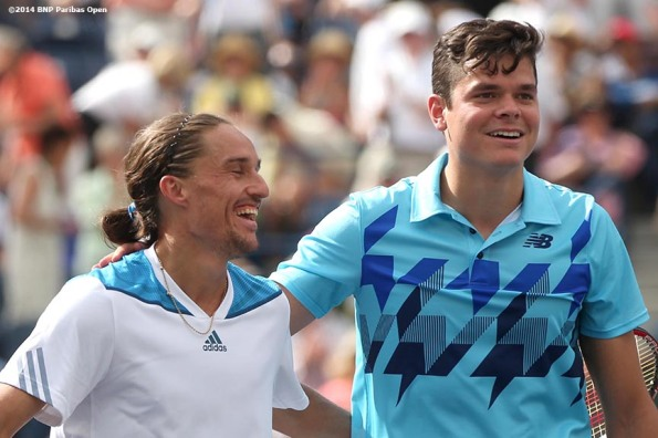 """Alexandr Dolgopolov and Milos Raonic laugh at net after Dolgopolov defeated Raonic in the quarterfinal of the 2014 BNP Paribas Open Thursday, March 13, 2014 in Indian Wells, California."""