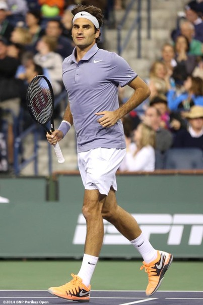 """Roger Federer reacts after defeating Kevin Anderson to advance to the semifinals of the BNP Paribas Open Thursday, March 13, 2014 in Indian Wells, California."""