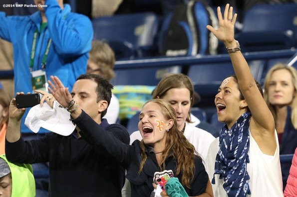 """Fans cheer during a match between Roger Federer and Kevin Anderson at the BNP Paribas Open Thursday, March 13, 2014 in Indian Wells, California."""