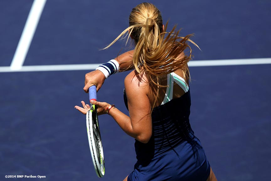 """Dominika Cibulkova hits a forehand in a quarterinal match against Li Na at the 2014 BNP Paribas Open Thursday, March 13, 2014 in Indian Wells, California."""