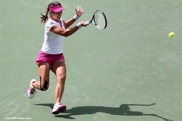"""Li Na hits a forehand against Dominika Cibulkova in a quarterinal match at the 2014 BNP Paribas Open Thursday, March 13, 2014 in Indian Wells, California."