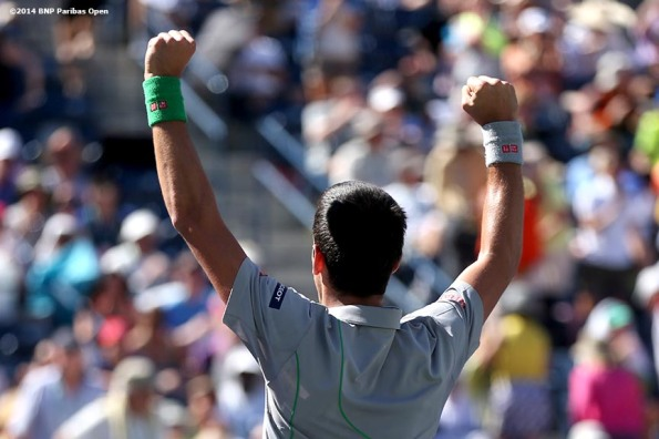 """Novak Djokovic reacts after defeating Julien Benneteau in the quarterfinal of the 2014 BNP Paribas Open Friday, March 14, 2014 in Indian Wells, California."""