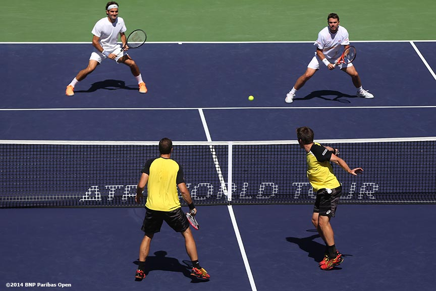 """Alexander Peya and Bruno Soares play Stan Wawrinka and Roger Federer in the semifinals during the 2014 BNP Paribas Open Friday, March 14, 2014 in Indian Wells, California."""