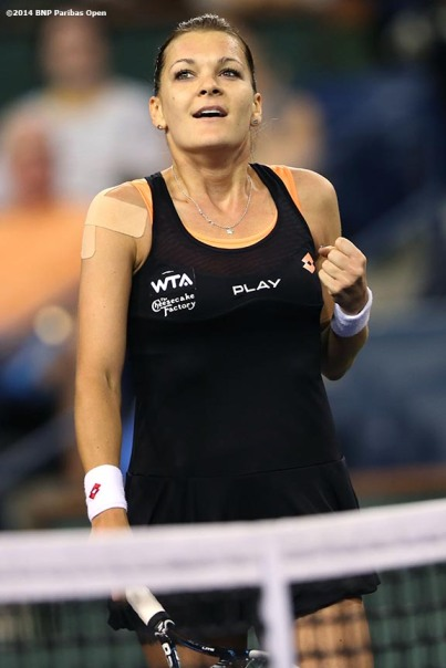 """Agnieszka Radwanska reacts after defeating Simona Halep in the semifinal of the 2014 BNP Paribas Open Friday, March 14, 2014 in Indian Wells, California."""