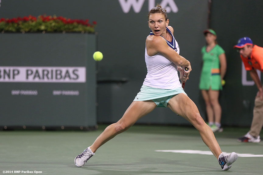"""Simona Halep returns a shot from Agnieszka Radwanska in the semifinal of the 2014 BNP Paribas Open Friday, March 14, 2014 in Indian Wells, California."""