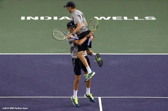 """Bob and Mike Bryan react after defeating Alexander Peya and Bruno Soares to win the 2014 BNP Paribas Open doubles championship Saturday, March 15, 2014 in Indian Wells, California."""