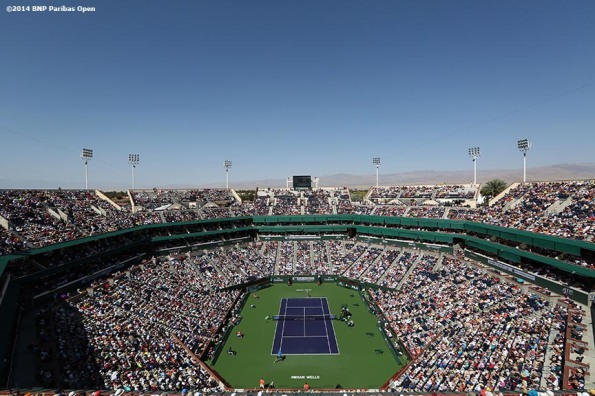 """Novak Djokovic plays John Isner in Stadium 1 at the Indian Wells Tennis Garden in the men's semifinals of the 2014 BNP Paribas Open Saturday, March 15, 2014 in Indian Wells, California."""