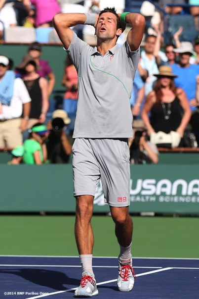 """Novak Djokovic reacts after defeating John Isner in the semifinals of the 2014 BNP Paribas Open Saturday, March 15, 2014 in Indian Wells, California."""