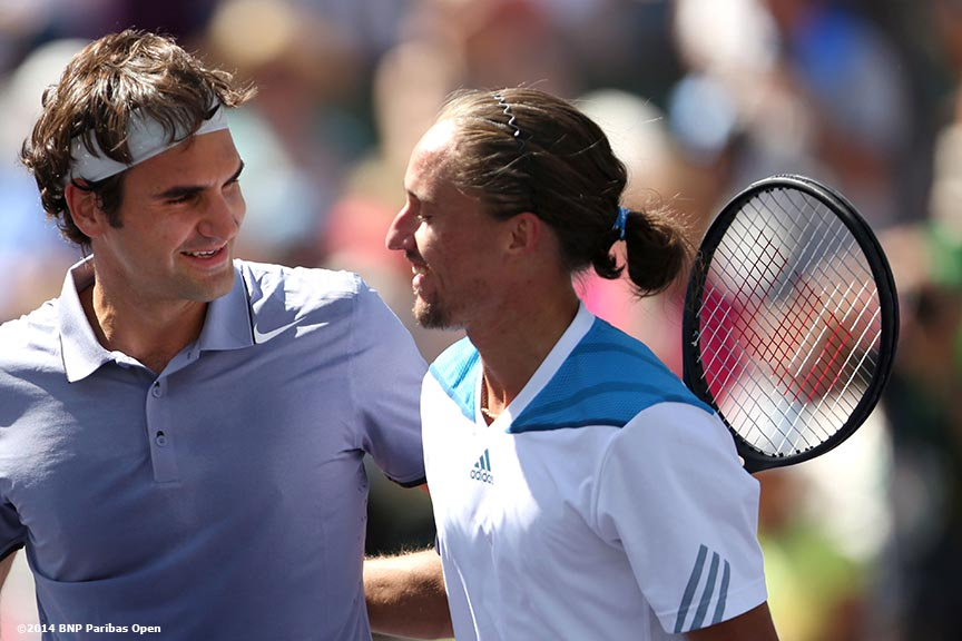 """Roger Federer and  Alexandr Dolgopolov shake hands after Federer defeated Dolgopolov in the semifinals of the 2014 BNP Paribas Open Saturday, March 15, 2014 in Indian Wells, California."""