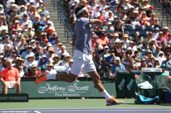 """Roger Federer hits a forehand against Alexandr Dolgopolov in the semifinals of the 2014 BNP Paribas Open Saturday, March 15, 2014 in Indian Wells, California."""