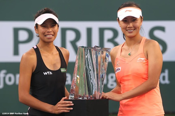 """Su-Wei Hsieh and Peng Shuai react after winning the women's doubles title over Cara Black and Sania Mirza at the 2014 BNP Paribas Open Saturday, March 15, 2014 in Indian Wells, California."""