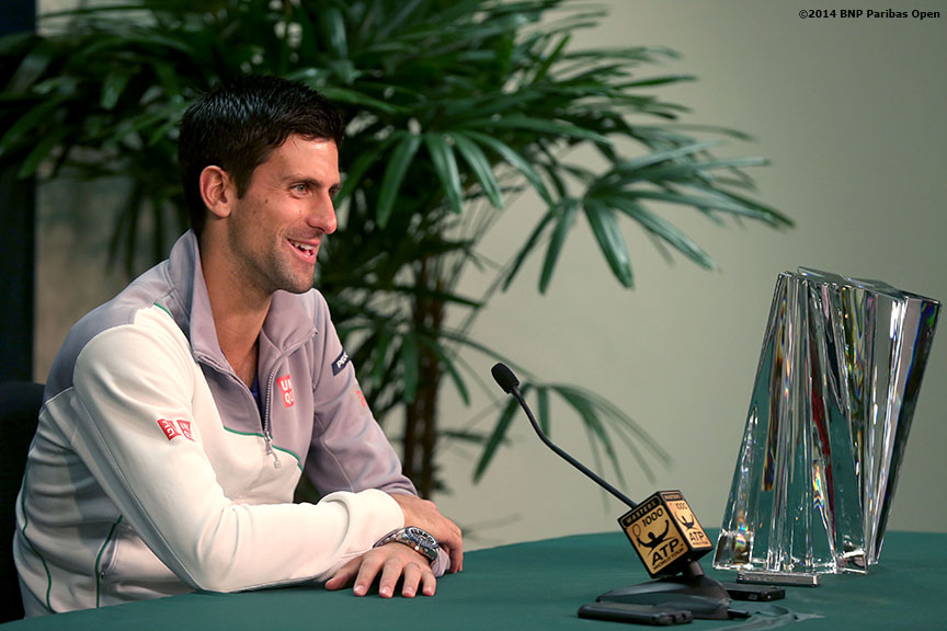 """Novak Djokovic addresses media after defeating Roger Federer to win the 2014 BNP Paribas Open men's singles championship Sunday, March 16, 2014 in Indian Wells, California."""