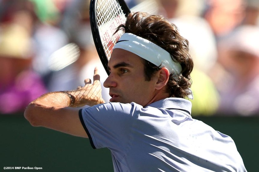 """Roger Federer hits a forehand during the 2014 BNP Paribas Open against Novak Djokovic Sunday, March 16, 2014 in Indian Wells, California."""