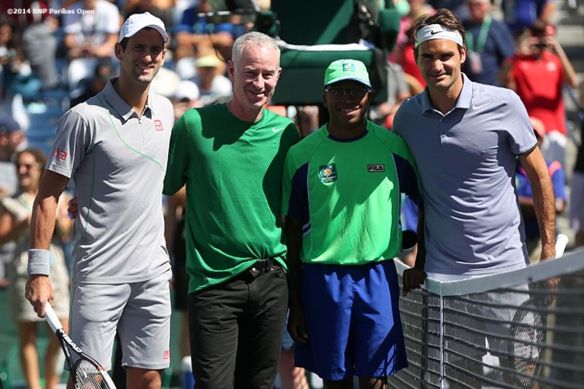 """Novak Djokovic, John McEnroe, a ball boy, and Roger Federer pose for a photograph before the 2014 BNP Paribas Open men's finals Sunday, March 16, 2014 in Indian Wells, California."""