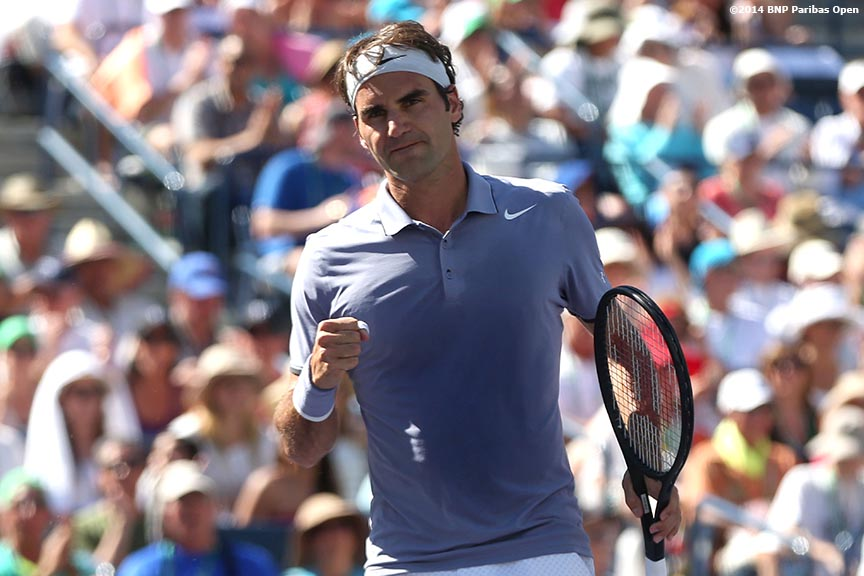 """Roger Federer reacts after winning a point during the 2014 BNP Paribas Open against Novak Djokovic Sunday, March 16, 2014 in Indian Wells, California."""