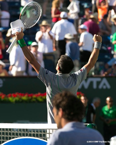 """Novak Djokovic reacts after defeating Roger Federer in three sets to win the 2014 BNP Paribas Open men's singles championship Sunday, March 16, 2014 in Indian Wells, California."""