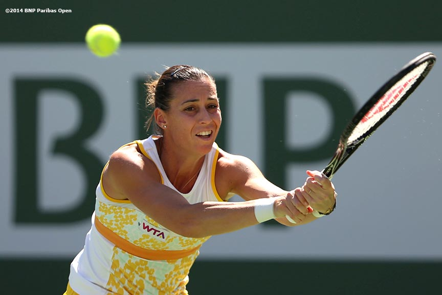 """Flavia Pennetta hits a backhand during the 2014 BNP Paribas Open women's finals against Agnieszka Radwanska Sunday, March 16, 2014 in Indian Wells, California."""