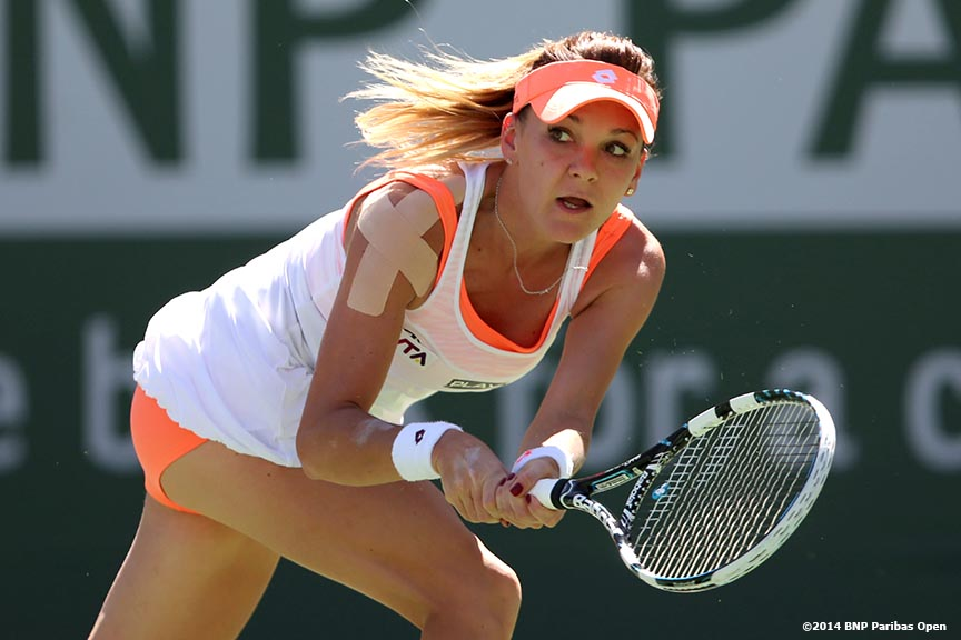 """Agnieszka Radwanska hits a backhand during the 2014 BNP Paribas Open women's finals against Flavia Pennetta Sunday, March 16, 2014 in Indian Wells, California."""