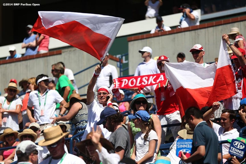"""Fans show support for Agnieszka Radwanska during the 2014 BNP Paribas Open women's finals against Flavia Pennetta Sunday, March 16, 2014 in Indian Wells, California."""