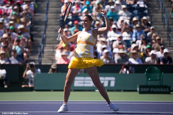 """Flavia Pennetta reacts after defeating Agnieszka Radwanska to win the 2014 BNP Paribas Open women's singles championship Sunday, March 16, 2014 in Indian Wells, California."""