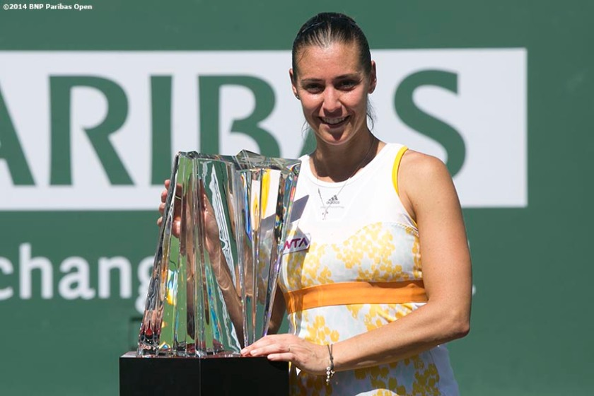 """Flavia Pennetta poses with the trophy after defeating Agnieszka Radwanska to win the 2014 BNP Paribas Open women's singles championship Sunday, March 16, 2014 in Indian Wells, California."""