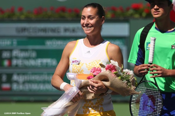 """Flavia Pennetta is introduced on court before the 2014 BNP Paribas Open women's finals against Agnieszka Radwanska Sunday, March 16, 2014 in Indian Wells, California."""