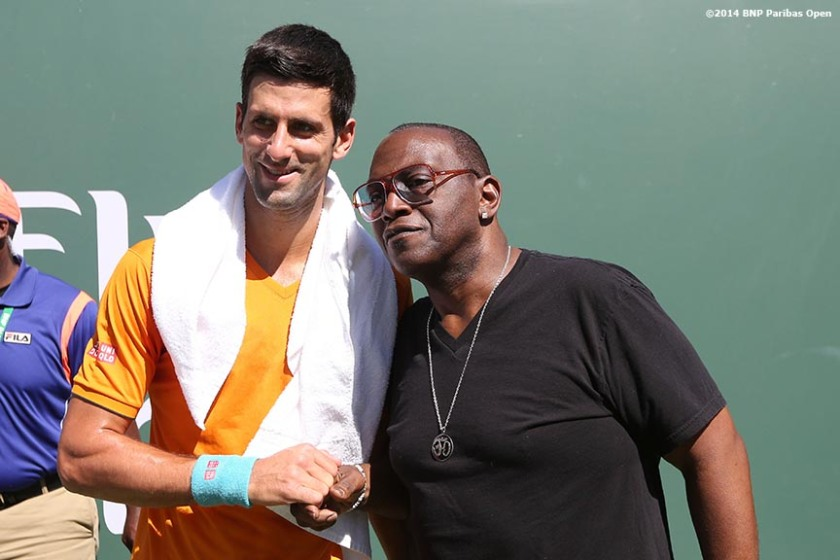 """Novak Djokovic and American Idol judge Randy Jackson pose for a photograph before the 2014 BNP Paribas Open men's finals Sunday, March 16, 2014 in Indian Wells, California."""
