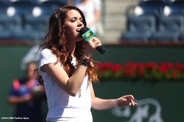 """American Idol finalist Angie Miller sings the National Anthem before the 2014 BNP Paribas Open women's finals Sunday, March 16, 2014 in Indian Wells, California."""