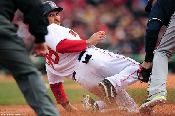 """Boston Red Sox center fielder Grady Sizemore slides as he steals third base during the second inning of the 2014 home opener against the Milwaukee Brewers Friday, April 4, 2014 at Fenway Park in Boston, Massachusetts."""