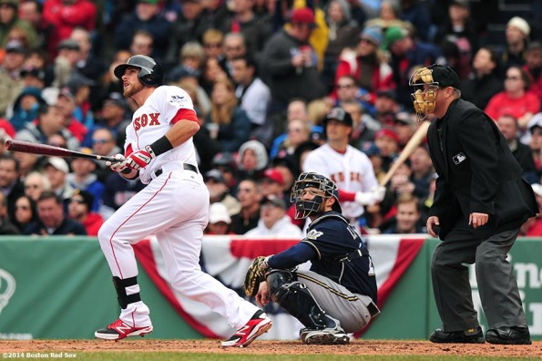 """Boston Red Sox third baseman Will Middlebrooks hits a solo home run during the third inning of the 2014 home opener against the Milwaukee Brewers Friday, April 4, 2014 at Fenway Park in Boston, Massachusetts."""