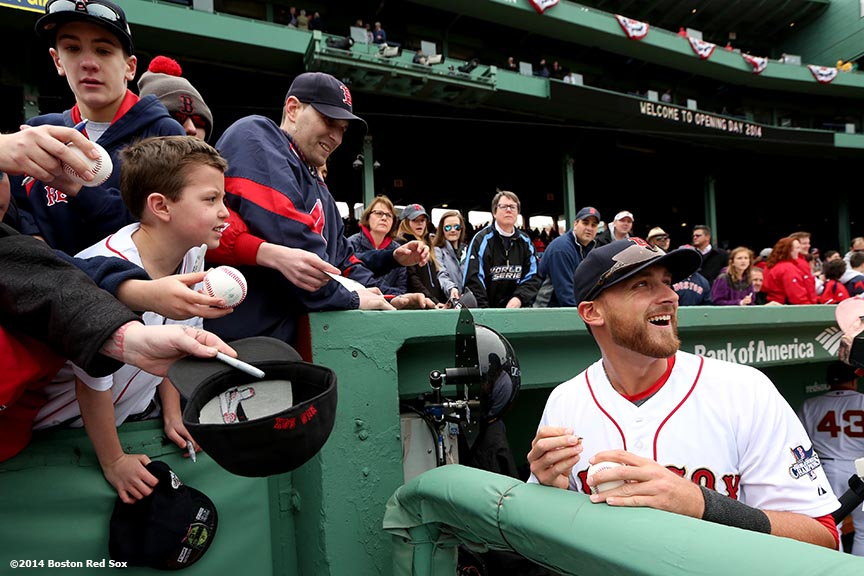 """Boston Red Sox third baseman Will Middlebrooks signs autographs during the World Series ring ceremony at the 2014 season home opener Friday, April 4, 2014 at Fenway Park in Boston, Massachusetts."""