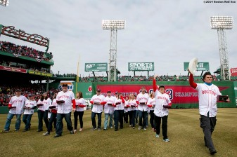 """Boston Marathon hero Carlos Arredondo and other victims, families, and heroes involved with the Boston Marathon bombings are introduced during the Boston Red Sox World Series ring ceremony at the 2014 season home opener Friday, April 4, 2014 at Fenway Park in Boston, Massachusetts."""