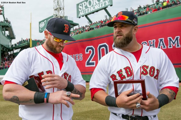 """Boston Red Sox left fielder Jonny Gomes and first baseman Mike Napoli receive their rings during the World Series ring ceremony at the 2014 season home opener Friday, April 4, 2014 at Fenway Park in Boston, Massachusetts."""