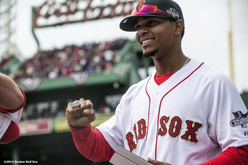 """Boston Red Sox shortstop Xander Bogaerts displays his ring during the World Series ring ceremony at the 2014 season home opener Friday, April 4, 2014 at Fenway Park in Boston, Massachusetts."""