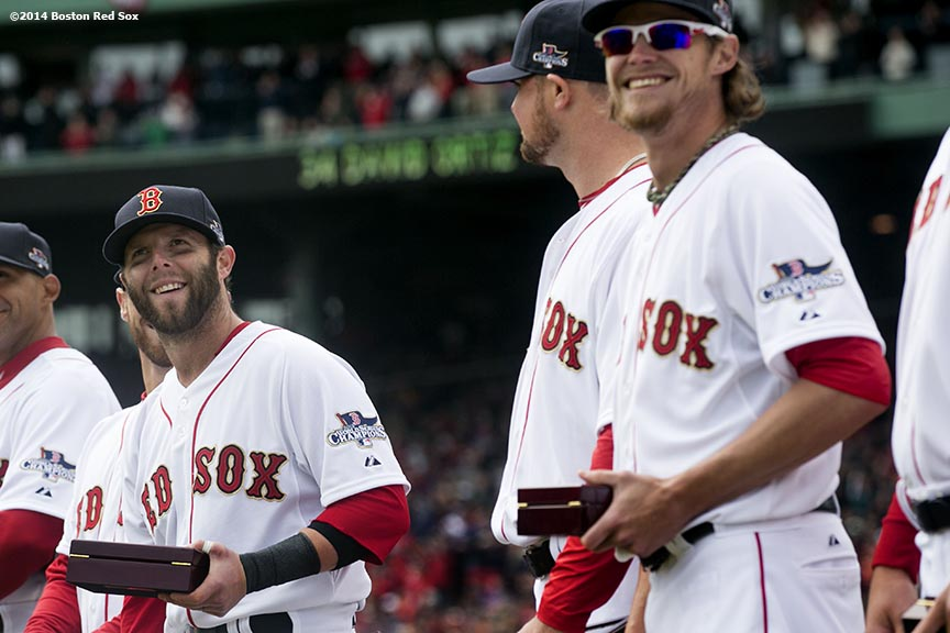 """Boston Red Sox second baseman Dustin Pedroia receives his ring during the World Series ring ceremony at the 2014 season home opener Friday, April 4, 2014 at Fenway Park in Boston, Massachusetts."""