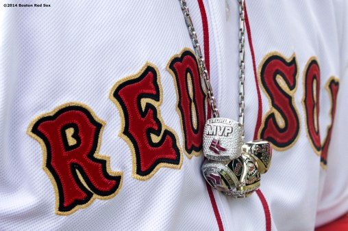 """Boston Red Sox designated hitter David Ortiz wears his 2004, 2007, and 2013 World Series rings and 2013 World Series Most Valuable Player ring on a necklace during the World Series ring ceremony at the 2014 season home opener Friday, April 4, 2014 at Fenway Park in Boston, Massachusetts."""