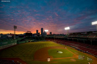 """The sun rises over Fenway Park on the morning of the 2014 Boston Red Sox home opener Friday, April 4, 2014 in Boston, Massachusetts."""