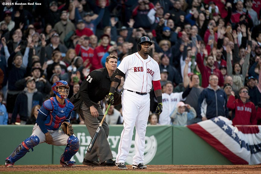 """Boston Red Sox designated hitter David Ortiz watches the ball fair as hits a go-ahead three run home run during the eighth inning of a game against the Texas Rangers at Fenway Park in Boston, Massachusetts Wednesday, April 9, 2014."""