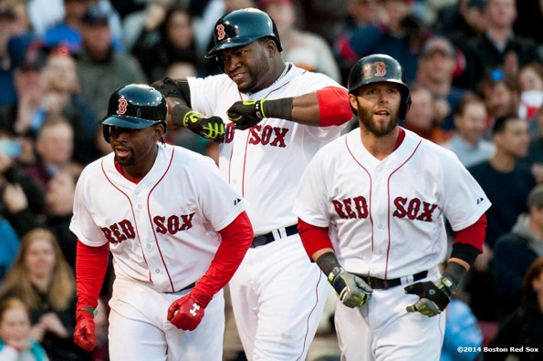 """Boston Red Sox designated hitter David Ortiz celebrates alongside Jackie Bradley Jr. and Dustin Pedroia after hitting a go-ahead three run home run during the eighth inning of a game against the Texas Rangers at Fenway Park in Boston, Massachusetts Wednesday, April 9, 2014."""