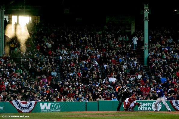 """Sunlight passes through a window during a game between the Boston Red Sox and the Texas Rangers at Fenway Park in Boston, Massachusetts Wednesday, April 9, 2014."""