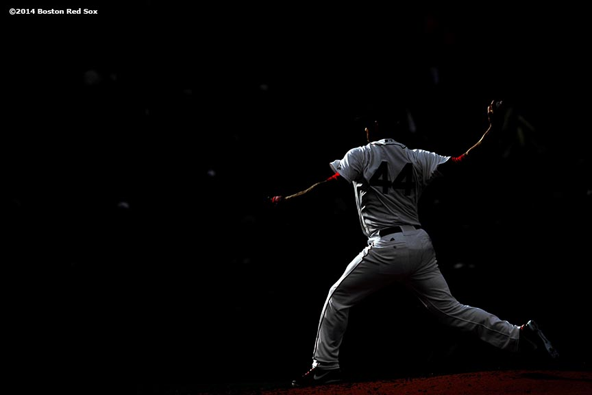 """Boston Red Sox pitcher Jake Peavy delivers during the third inning of a game against the Texas Rangers at Fenway Park in Boston, Massachusetts Wednesday, April 9, 2014."""